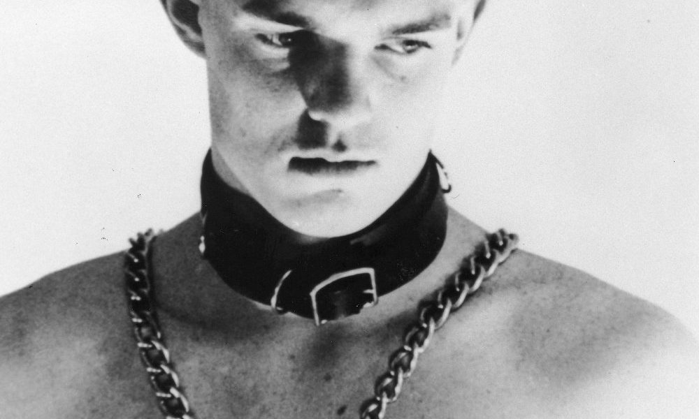 no-skin-off-my-ass-1991-001-klaus-von-brucker-skinhead-leather-collar-chains-on-bare-chest